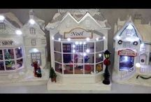 Dickensville Christmas Village / Dickensville collectable lighted buildings and Frosty Village series.