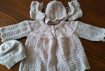 My Knitting / Feather and Fan Layette with an extra beanie. Used Bendigo Yarn 4ply luxury. Made for my cousin's 1st grandchild