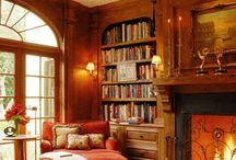 LIBRARY with Fireplace and a cozy chair.