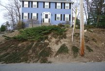 """Slope Retention Using Historic Granite / Using """"re-purposed"""" granite materials from our inventory, we designed and built a functional and aesthetically pleasing front yard."""