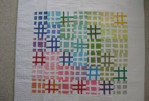 Rainbows / Quilts made in rainbow colours, inspiration for using rainbow charm packs - put your sunnies on this board is bright!