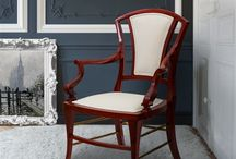 Majesty   Armchair / Members and relatives of the British Royal Family historically represented the monarchy in various places throughout the British Empire. 'Majesty', is a truly heartwarming piece that remains all the elegance of the English royalty. Manually produced by the best craftsmen in a very particular wood with subtly orange touches that will darken over the years, this piece thus becomes timeless.