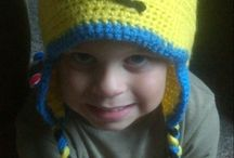 Babies And Baubles By TC (Etsy store) / Hand crocheted hats and earflap beanies for babies, children, and adults. Great for birthday parties and photo props or just for gift giving! Thing 1 Thing 2, Minion (despicable me), pumpkin hat, Bailey Bear Cowl, motorcycle diaper cakes, etc. We will be adding new items regularly.
