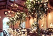 Wedding theme: upscale rustic / A mix of elegance & rustic elements: Lanterns, barns, wooden signs combined with garden roses, lush arrangements, gold and silver containers.