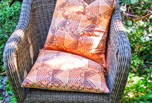 Afro Tribal Textile Collection / Our fabrics are screen printed by our highly skilled printers, at our factory in Muizenberg, We have selected a lovely range of natural cottons and linen base cloths which are suitable for curtaining, cushion covers and upholstery.