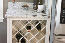 Warrenton I / The stunning cabinetry in this Warrenton kitchen is form Holiday Kitchens. The door style is Summit Square and its finished in Snowdrift paint with a Mink Wash Glaze. The glass inserts above the wine rack give this kitchen a more transitional look.