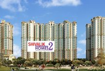 Shivalik Homes 2 Noida Extension / COSMOS INFRAESTAE (P) LTD. presents Shivalik Homes 2 a high rise luxurious and affordable residential complex ideally situated in the heart of the city approx 6Km from Pari Chauk, a location is cherished by all. The Place has all the basic as well as modern amenities which are requisite for residential area. Here the life is full of exotic luxury and elegant comfort.