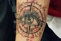 compass with eye tattoo