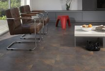 Vinyl / Ease of cleaning and durability make vinyl a top choice for wet and high-traffic areas including kitchens, bathrooms, recreation areas and other well-used rooms. In addition, vinyl is soft and warm underfoot.  http://www.eheartdesign.com/products/vinyl/ / by Eheart Interior Solutions