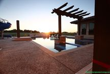 """Victor  Meyers Custom Homes - AGT / This glowing concrete pool deck was created by seeding Ambient Glow Technology - AGT Sky Blue 1/2"""" Glow Stones on the surface of curing concrete. The Glow Stone is trowelled in to the surface of the concrete and then a retarder is sprayed on the surface to expose the AGT Glow Stones. The Glow Stones store energy from the sun and give off that energy all night..."""
