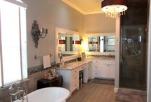 Bathrooms / Couto Homes displays fun yet classy designs in each bathroom.  See for yourself.