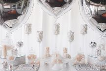 Silver Wedding Sweet Station / Draped in a luxurious silver sequin tablecloth and illuminated by silver mercury tealights this beautiful sweet station was adorned with custom designed chocolate bars, beautifully placed on a bed of white chocolate drops and surrounded by an abundance of white & silver sweet candy treats. The silver heart balloons complimented the Bride & Grooms style, and made for a fantastic feature piece to this delightful sweet station.  Youtube: www.youtube.com/watch?v=0lHITVyq-3A  Enchanted Empire