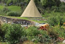 Glamping. / Our Tipi and Tourist Tents overlook  Orongo Bay & the Park BBQ area from an elevated position. Lodge kitchen and Bathroom use are included.