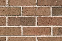 Pine Forest   Triangle Brick Company / Give your exterior cladding a crisp, natural look with Triangle Brick Company's Pine Forest brick, offered as part of our Standard tier. Hues of deep evergreen and other rich earth tones make this brown, sand-faced brick one of our most unique products and help your project blend beautifully into its surrounding environment. Build with a brick that highlights the best that nature has to offer with Pine Forest.