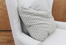 Mary's Wingback Slipcover / A custom-made slipcover in versatile natural canvas updates this traditional wingback chair.