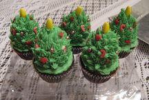 xmas tree cupcake / chocolate muffins with a fresh strawberry and orange butter cream