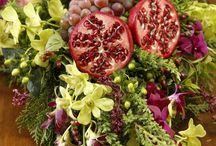 arranjos flores e frutas