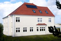 Edernish Island / Located on Edernish Island, a tiny private atoll on Ireland's North West coast, sits a home completely at ease in the tranquillity of its striking surroundings. That is, in part, thanks to the reroofing recently completed using Redland's Rosemary Clay Classic tiles, Dry Hip system and DryVent Ridge.