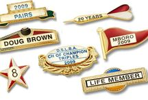 Metal Name & Club Badges / Name Badges International produces durable metal pins and badges of wide range with Versatile designs. These badges can be easily attached to shirts, jacket lapels, hats or bags. For help on badge design suggestions please give us a call on 02 8003 5046 or email us.