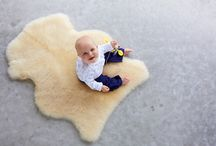 Baby on board / Deliciously warm baby and infant sheepskin products to look after the little ones. Specially treated infant care rugs are designed to be gentle on new skin.