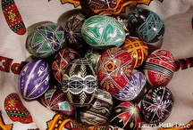 Pysanky - Ukrainian Easter Eggs / Traditional pysanky are Ukrainian Easter eggs made by applying melted beeswax to a raw egg with a tool called a kistka that is heated over a candle flame to melt the wax. The designs on pysanky are traditional and have been used for hundreds of years. I have been making these eggs since I was a little girl. My father taught me, as his parents were from Ukraine. Process: A design is lightly drawn on the egg with a pencil and then covered with melted beeswax (process similar to batik). Once the wax is applied to areas of the white egg the egg is then dipped into a light colored dye such as yellow, and then more wax is applied to the parts of the egg that you want to keep yellow. Then the egg is then dipped into the next darker color, usually orange, (colors must be done in a certain order, light to dark) and then more wax is applied to the areas you want to make orange, and the process is repeated until the egg is covered in wax and all desired colors have been used. Then the wax is melted off over a candle flame. When finished, the inside of the egg is then blown out with a tool, or some people just let them dry out naturally (I empty my eggs). The finished egg is then left to dry out and then usually varnished. Some of my process photos are a little blurry - I will try to take some better photos of the process when I do my eggs this year.