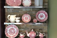 Red and white transfer ware / Red and white transferware on metal floating shelves. shadow stone backsplash