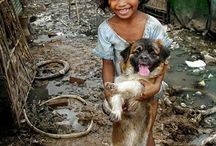 Cambodia girl with her dog