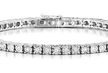 Diamond Bracelets / With sheer brilliance and refinement, our diamond bracelets are designed to accessorise your biggest occasions. Made with luminous high grade diamonds, their sparkle and quality go unrivalled...