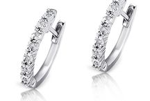 Hoop Earrings / If you're looking to turn heads, a pair of sparkling diamond hoop earrings has a simply breathtaking effect. Their seductive dazzle and shine will bring out your inner goddess...