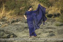 Blue Flame Pure Silk Chiffon Saree with Orange Tassels and Blouse Embroidery / PRICE: INR 6,321; US$ 95.77 To buy click here: https://goo.gl/FdPrde Featuring the Blue Flame saree in deep navy blue, 100% flat, pure silk chiffon fabric with neon orange tassels decorated along the edges. The synthetic raw silk blouse has neat, fresh orange flowerbeds embroidered with green foliage that stand out against the stark navy blue backdrop for beautiful results, as though emulating the bright sparks from a blue flame. Reach us at care@eastandgrace.com. With Love, www.eastandgrace.com