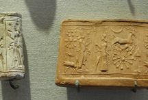 Cylinder Seals / A cylinder seal is a small round cylinder, engraved with written characters or figurative scenes or both, used to roll an impression onto a two-dimensional surface, generally wet clay. Cylinder seals were invented around 3500 BC in the Near East, at the contemporary site of Susa in south-western Iran and at the early site of Uruk in southern Mesopotamia. They were used as an administrative tool, a form of signature, as well as jewelry and as magical amulets (Wikipedia, s.v. 'Cylinder seal').