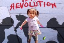 """Parents of the Revolution / """"Parents of the Revolution"""" follows a group of activist parents in the Occupy Wall Street movement who believe that it's their democratic duty to teach their kids to speak out against injustice. Are they heroes who are bringing up their kids with a civic conscience or agitators who are using their children as human shields?"""