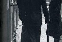 a man with black coat & umbrella