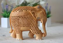 Wooden Anniversary Gift Ideas For Him / Hand carved wooden elephant with very intricate carving of peacocks on its body. Makes a great gift idea for a friend who shares any of the traits that make these fascinating animals so iconic.