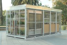 """CAMPING /  Located in the rooftop of Buenos Design center (Recoleta). This """"pop-up box"""", called the """"Camping's shelter """", works with the green  and nature that surround it. The translucent  facade and the thin white metal structure,   was designed to fold itself  and open entirely, working  as a light  filter that contains plants and all the functions for the store. During the night, this space look like a lantern in the rooftop, transparent, lighting and green .  ."""