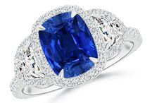 Claw Royal Sapphire and Diamond Halo Three Stone Ring