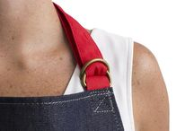 DENIM APRON / The elastic waistband on this Apron makes it more comfortable when bending down to open the oven or during gardening. It also has a useful small pocket for pens/phones, and an easily accessible deep pocket for big things. Angled ergonomic pocket openings. Reinforced stitching and rivets around pocket edges. Semi-elasticated waistband to add flexibility. Double D-ring fastener. Available in stripe or denim.