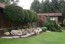 Walls and all / Retaining walls, sitting walls, terraces, stone borders, etc. built by our hardscape crews.