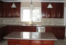 Kitchen Renovation with Designer Lighting Accents / A kitchen renovation complete with recessed high hat lighting, under the cabinet lighting and pendant lighting over the island in Bergen County New Jersey.