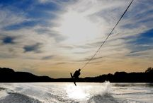 Wake Boarding. / Wakeboarding is a surface water sport which involves riding a wakeboard over the surface of a body of water. It was developed from a combination of water skiing, snowboarding and surfing techniques.