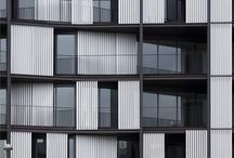 Facades / the face of a building, especially the principal front that looks onto a street or open space.