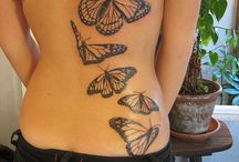 tattoos / by Penny Kidwell