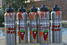 Custom sport bottles and spirit items.  / Examples of custom products offered by Confetti Monkey that help you show your team spirit.