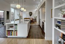 Hilltop Flat / The original floor plan and finishes presented a challenge, but the bones and location were too good for the client to pass up. A walled-in kitchen was closed off from the floor-to-ceiling windows and mismatched neoclassical trim was at odds with the building's vintage.  By eliminating walls, the new design unifies kitchen-living-and-dining into a grand space optimized for the downtown view. An earthy blanket of patterned concrete tile defines the kitchen and wraps up the cooktop/backsplash.