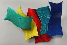 Metal Wall Sculptures / Colored metal sculptures that consist of single panels of powdercoated aluminum that display attention grabbing assemblage.