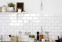 The Playlist Generation Kitchen / kitchen finishes- white laminate cabinets, butcher block wood counter, white subway tile backsplash, colorful refrigerator, new kitchen faucet