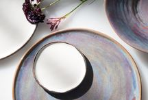 JS 158 Aurora Borealis Tableware / We decided to make the plates in this collection from a bright white stoneware clay body. We glazed the Dinner Plate in rich purple, blue and coffee colors, and glazed the Appetizer and Bread & Butter Plate in bright white with a rustic, bronze edge. The bowls and vessels are made from a bright white translucent porcelain clay body. The Soup Bowl is glazed the same as the Dinner Plate, and the Salad Bowl is bright white with a bronze edge.