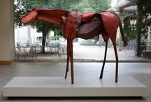 """Deborah Butterfield / Aspiring veterinary student turned sculptor, Deborah Butterfield received a NEA grant to work on a series of sculptures depicting horses.  Her life-size works, though not realistic representations, convey her expert knowledge of equine anatomy.  """"Vermillion"""" is located in the POB atrium at the University of Texas in Austin. GPS: 30.286674,-97.736785"""