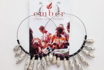 Ember Arts / Ember Arts, partners with 28 Ugandan women, survivors of war and poverty, who are now jewellery artisans. They create unique, handmade jewellery made from recycled paper.