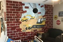 Construction Mural / Dana www.kidmuralsbydana.com in AZ painted this for her two boys who are obsessed with construction vehicles. Both boys have a serious love for dump trucks and dirt. She had the vision of a wrecking ball busting through the wall. Once the idea was drawn on paper it was time to make it come alive! The wrecking ball is a large styrofoam ball attached to the wall with fishing wire and a cheap plastic chain from Home Depot. Boys room decor - decor for kids - boys room decor - decor for boys - construction theme - construction decor - construction mural - murals for kids - kids rooms